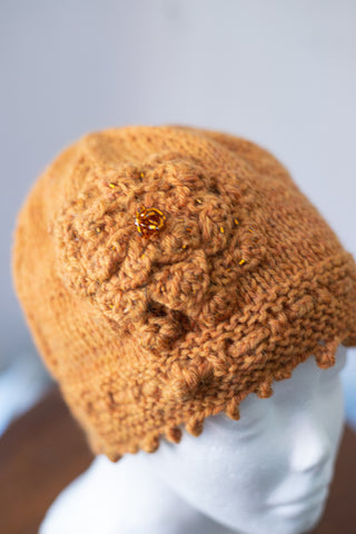 Knitted Gold cloche hat with rosette