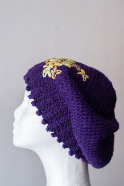 Purple beret with embellished flowers