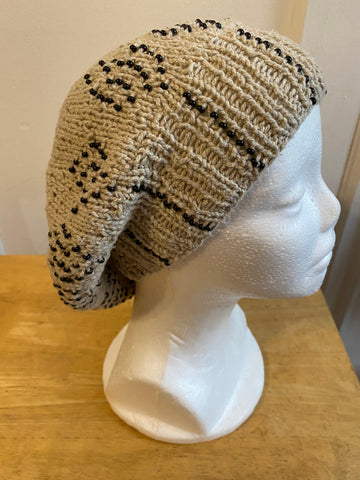Knitted cotton and silk beanie in beige with black seed beads