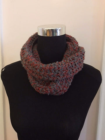 Knitted cowl in burnt orange and gray with seed beads