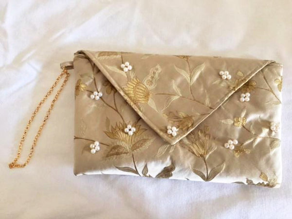 Evening bag in gold silk brocade