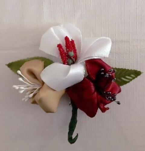 Red, white, and gold holiday corsage