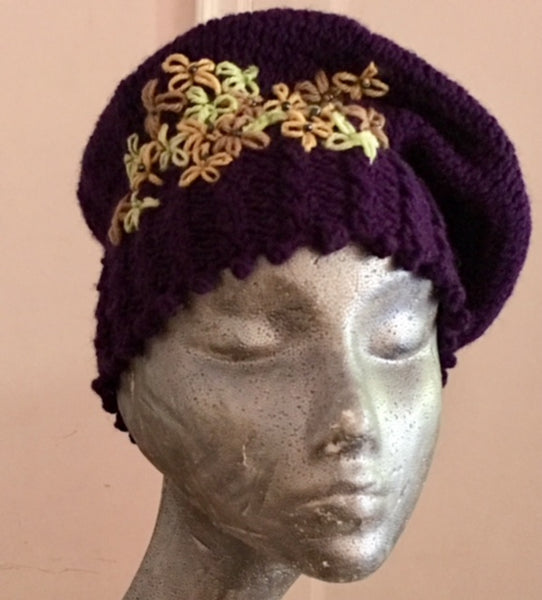 Knitted cowl in multi-colored yellow and purple wool