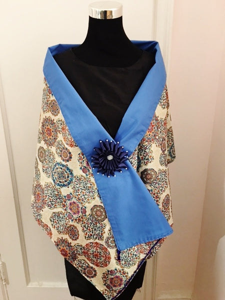 Medallion shawl with navy blue flower brooch