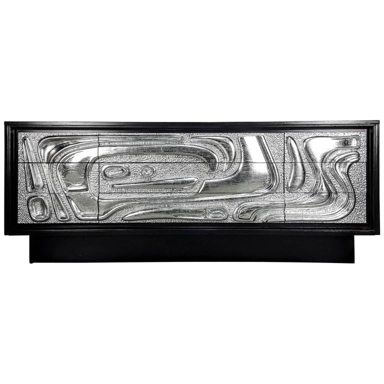 Sculptural Ebonized Credenza with Silver Leafed Front