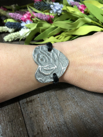TRADES BY HAIM SHAHAR RECYCLED ALUMINUM ROSE HEART ON LEATHER BRACELET
