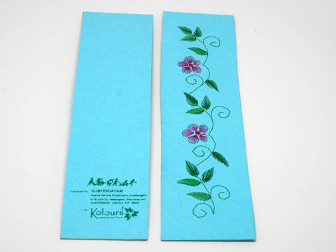 Sky-blue bookmark embroidered by hand