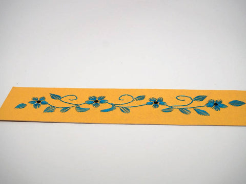 Yellow bookmark embroidered by hand
