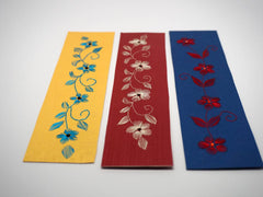 three colorful bookmarks embroidered by hand