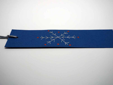 Blue bookmark embroidered by hand