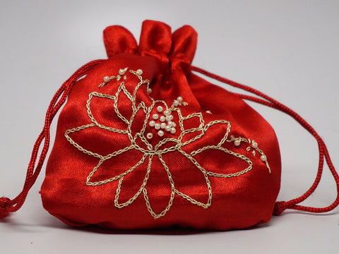 Red pouch with hand embroidered lotus flower