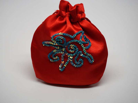 Red pouch with handmade embroidered sun