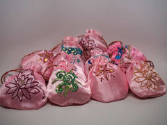 10 assorted pink pouches with handmade embroidery