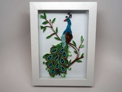 Framed handmade peacock with paper filigree