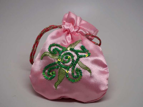Pink pouch with handmade embroidered sun