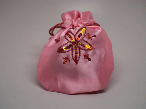 Pink pouch with handmade embroidered star flower