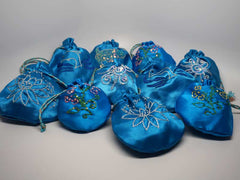 10 assorted blue pouches with handmade embroidery