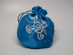 Blue pouch with handmade embroidered sun