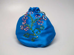Blue pouch with handmade embroidered flower