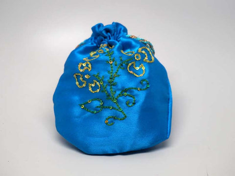 Blue pouch with handmade embroidered golden flower