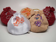 5 assorted pouches with handmade embroidery