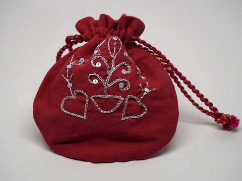Wine color pouch with handmade embroidered silver design