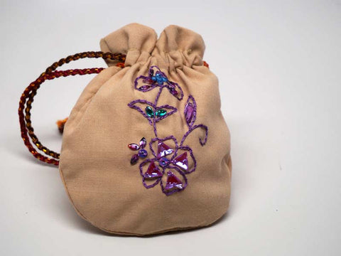 Cipria color pouch with handmade embroidered violet flower