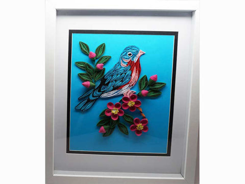 Framed handmade bird with paper filigree