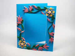 Photo frame with handmade paper filligree flowers decorations