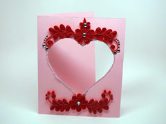 Photo frame with handmade paper filligree love decoration
