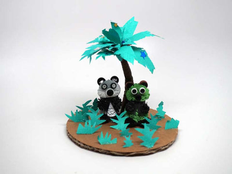Pandas made with paper filigree