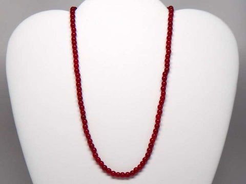 Handicraft necklace with light red hard stones