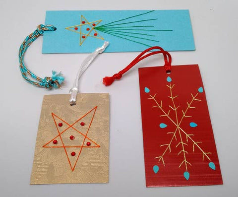 Assorted Christmas gift tags embroidered by hand