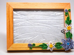 Paper filligree 3D photo frame with handmade flower decorations