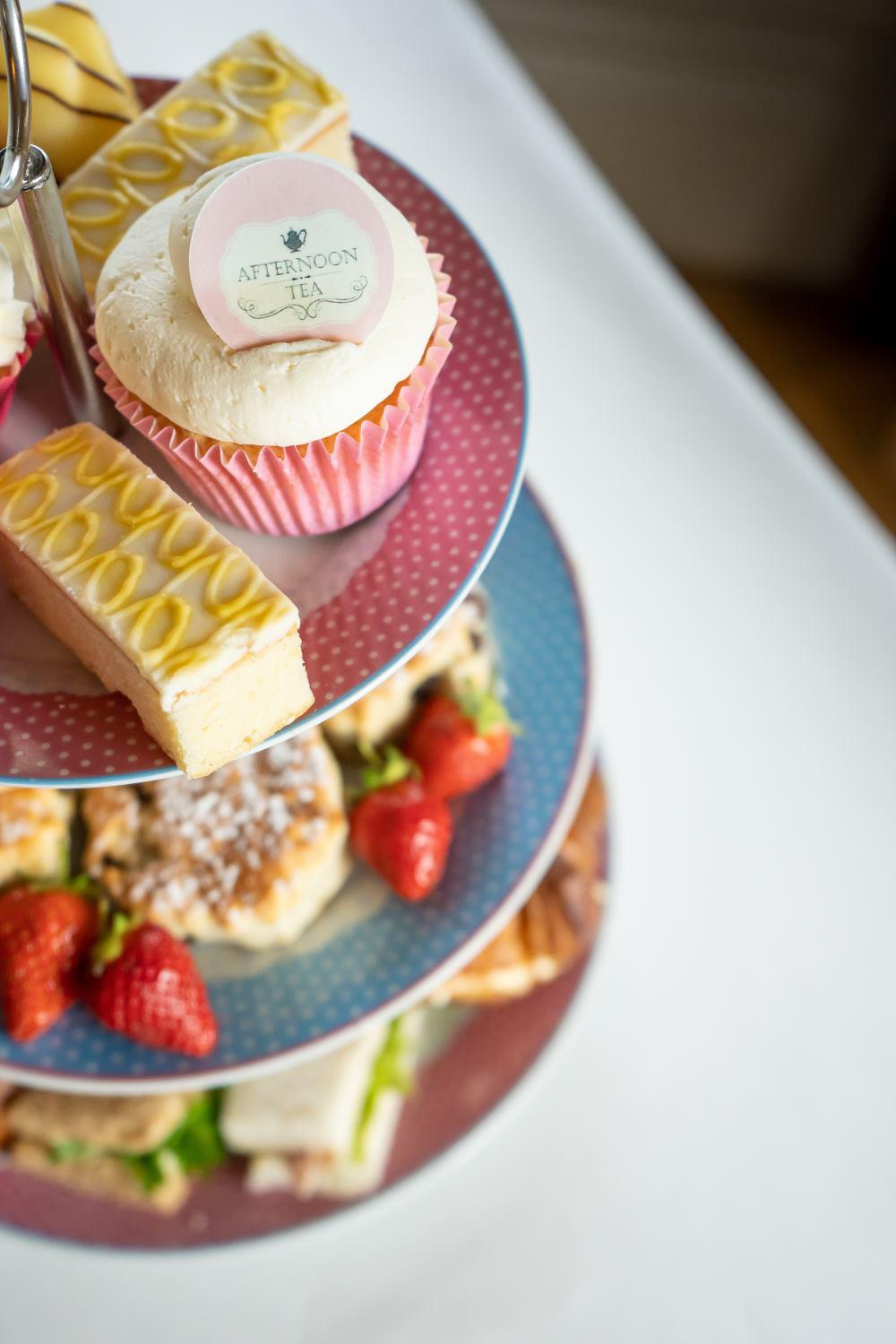 Afternoon tea with branded cupcakes using printed edible toppers