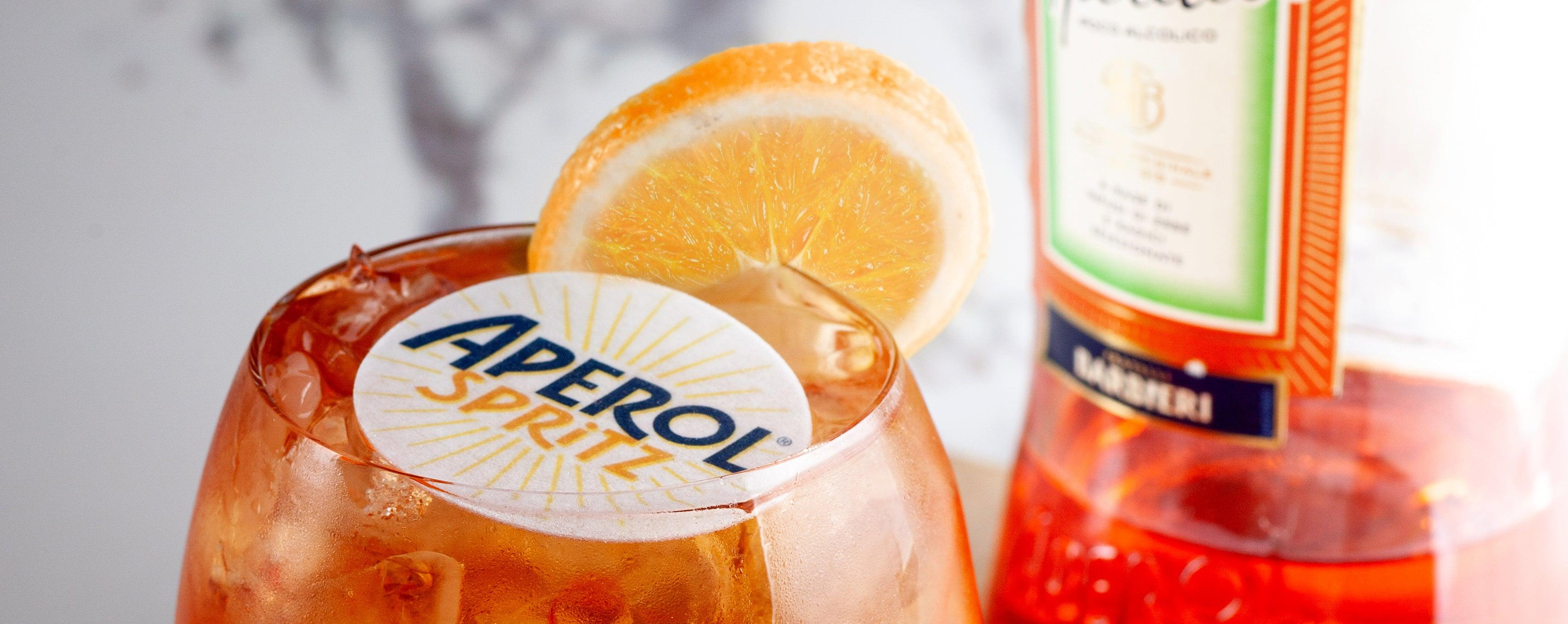 Aperol Spritz with branded cocktail topper