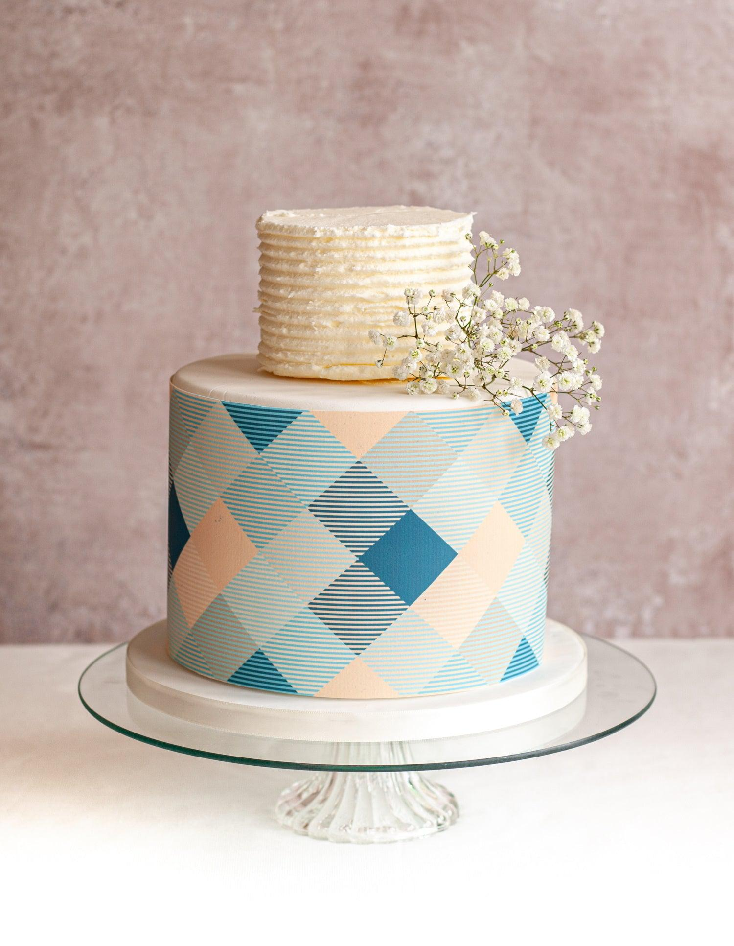 Two tier cake with blue and peach check icing cake wrap around