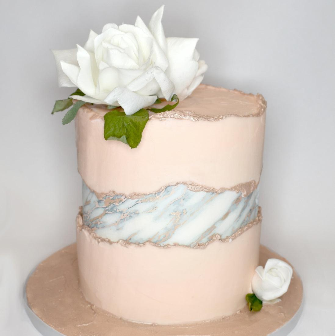 White and Rose Gold Marble cake wrap used for a faultline cake