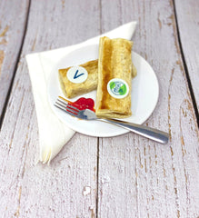 Vegan sausage roll labelled with vegan printed rice paper toppers