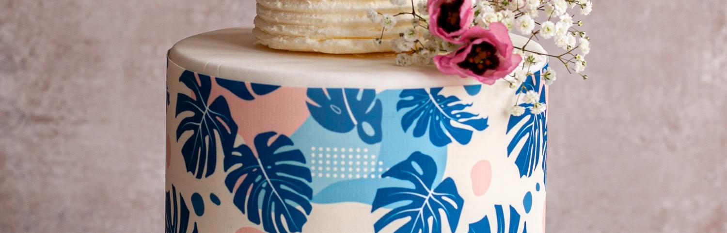Large cake with Tropical Leaves cake wrap in pink and blue