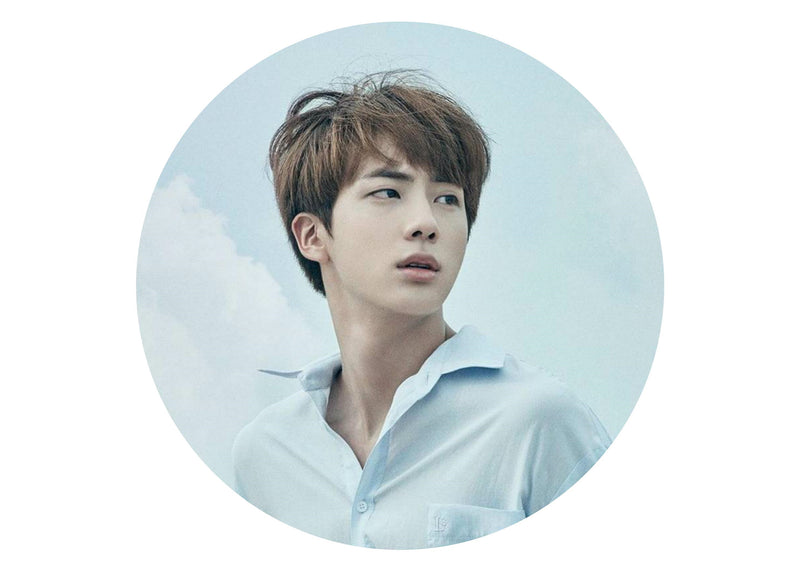 Large cake topper with images of Jin from BTS