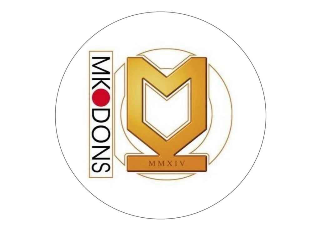 large cake topper with the MK Dons badge