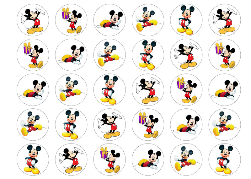 Edible cupcake toppers with Mickey Mouse pictures.
