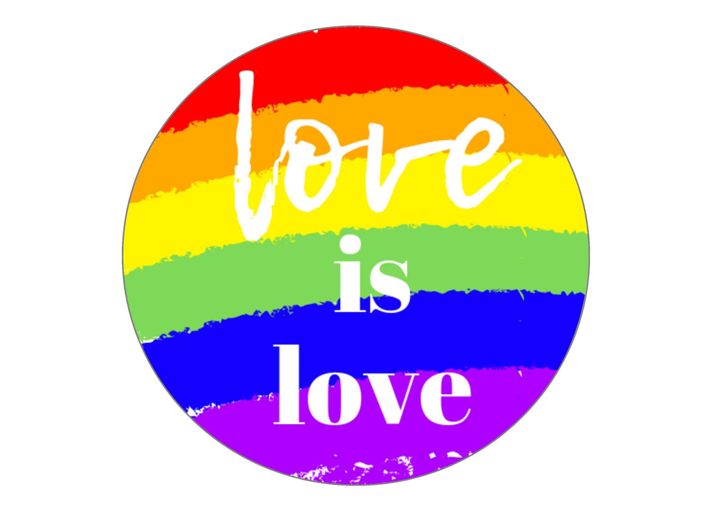 Large round cake topper with a love is love theme for LGBT Pride