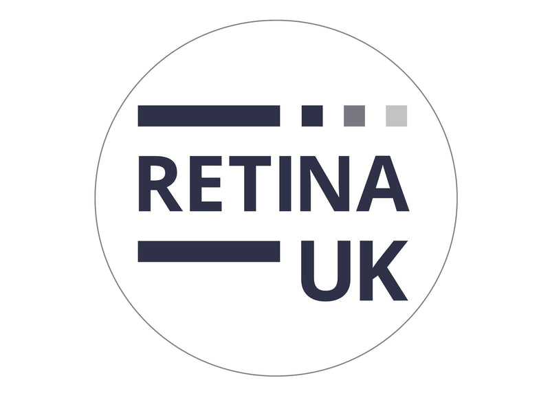 large round cake topper with the Retina UK logo