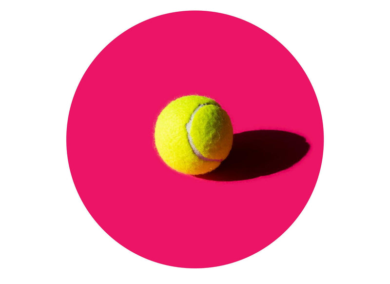 Large round cake topper with a tennis ball image