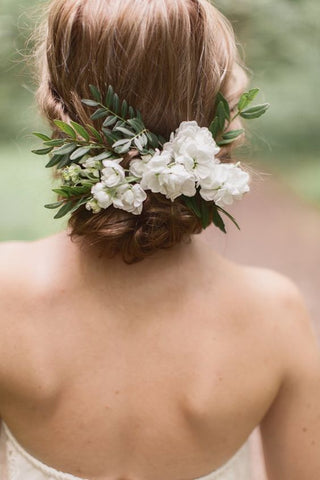 brides wearing fresh flowers in their hair for wedding