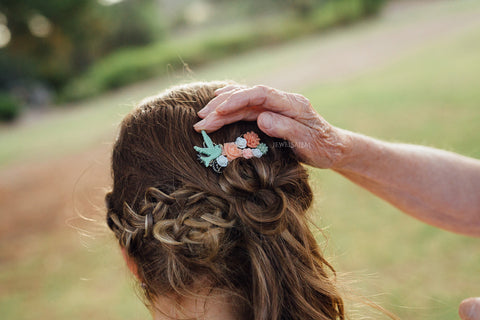 coral mint bird hair comb on bride wedding photo