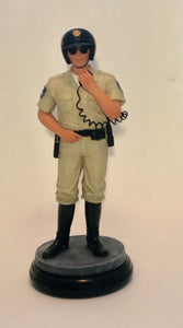 Standing Police Officer figurine on hand radio