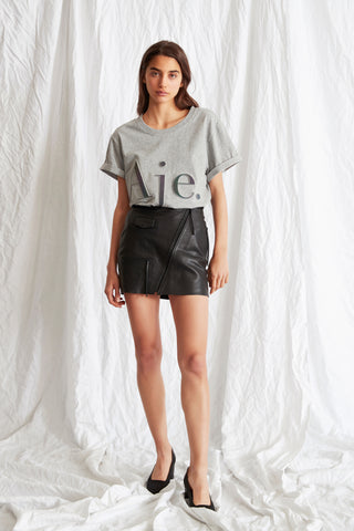 Reminiscent of '60s style, the Aje Twiggy Mini is a modern update on this classic. With a flattering high waisted cut and pocket detailing, the highly wearable style is the versatile piece of the moment. Asymmetric zip detailing on front. Subtle A-line silhouette.